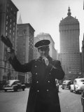 Park Avenue Doorman Using Whistle to Flag Down a Taxi For One of the Residents of His Building Premium Photographic Print by William C. Shrout