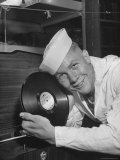 US Sailor Holding a Phonograph Record Premium Photographic Print by Frank Scherschel
