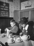 Mrs. Robert Neve and Son Peter Eating Supper in Restaurant Premium-Fotodruck von Hans Wild