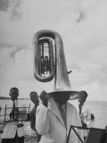 Tuba Player Keeping His Head Dry in a Rainstorm During Visit to St. Croix by Pres. Harry S. Truman Photographic Print by Thomas D. Mcavoy