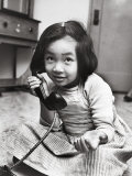 Young Girl Talking to Santa Claus on the Telephone Premium Photographic Print by Martha Holmes