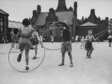 Peter Neve Playing with Other Children in Schoolyard Premium-Fotodruck von Hans Wild