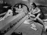 Twin Teenage Girls Reading and Writing Letters in Their Room Premium Photographic Print by Fritz Goro