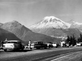 Tourist Looking at Mt Rainier in Southwest Washington Photographic Print by J. R. Eyerman