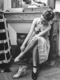 Model Changing Her Shoes For Pierre Balmain's Fashion Show Premium Photographic Print by Nina Leen