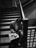 MIT Student Sitting in Stairwell to Fill Out Registration Forms For Second Semester Premium Photographic Print by Gjon Mili