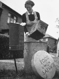Mrs. Robert Neve Emptying Food Scraps Into Pig Food Salvage Bin at the End of Her Street Premium-Fotodruck von Hans Wild
