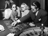 Playing the Roulette Wheel in a Las Vegas Club Premium Photographic Print by Peter Stackpole