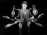 Stroboscopic Image of Juggler Stan Cavenaugh Juggling Tenpins Photographic Print by Gjon Mili