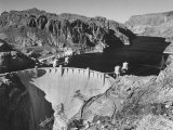 View of Boulder Dam, 726 Ft. High with Lake Mead, 115 Miles Long, Stretching Out in the Background Premium Photographic Print by Andreas Feininger