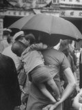 Woman Carrying Young Child on Her Back Through Marketplace on Queen's Road Premium Photographic Print by John Florea