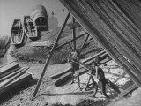 Two Men Working on a Handsaw at the Lumber Mill on the Banks of the Yangtze River Premium Photographic Print by Jack Wilkes