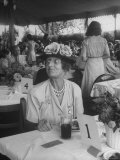 Mrs. Fletcher Harper Sitting at Table at Warrenton Horse Show Premium Photographic Print by Martha Holmes