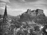 The Edinburgh Castle Sitting High on a Rock Above St. Cuthbert's Church Premium Photographic Print by Hans Wild
