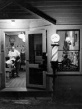 Small Town Barber Grover Cleveland Kohl Working in His Shop at Night Papier Photo par Alfred Eisenstaedt