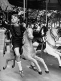 Young Turkish Prodigy Hassan Kaptan Riding a Merry Go Round Reproduction photographique sur papier de qualité par Gordon Parks