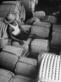 Worker Resting on Finished Product at Rope Factory For Making Hemp Premium Photographic Print by John Florea