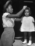 Mother Grooming Her Daughter For Healthiest Baby Contest Held at All African American Fair Premium Photographic Print by Alfred Eisenstaedt