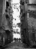 Slum Street with Laundry Hanging Between Buildings Photographic Print by Alfred Eisenstaedt