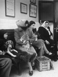 Women and Children Holding Pets While Waiting to See Veterinarian Photographic Print by Nina Leen
