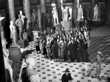 Sightseers Gaping Up at the Sculpture of Great Senators in the US Capitol Building's Hall of Fame Premium Photographic Print by Margaret Bourke-White