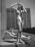 Model Wearing Sunglasses and Swim Suit Sunbathing on Roof of Rockefeller Center Premium Photographic Print by Alfred Eisenstaedt