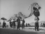People Carrying Large Dragon in Spring Festival Parade Premium Photographic Print by George Lacks