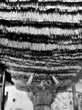 Worker at Pasta Factory Inspecting Spaghetti in Drying Room Fotoprint van Alfred Eisenstaedt