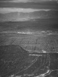 San Fernando Valley Seen from Point over Hollywood. Building Atop Mountain is Don Lee TV Station Premium Photographic Print by Loomis Dean