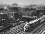 Train Moving Past Trackside Tenement Slums of Chicago Photographic Print by Gordon Coster