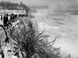 View of Visitors Watching Ice Formations at the American Side of a Frozen Niagara Falls Premium Photographic Print by Margaret Bourke-White