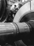 Workman on Large Wheel That Looks Like Fan, at General Electric Laboratory Premium Photographic Print by Alfred Eisenstaedt