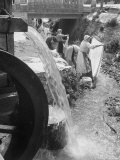 Washerwomen Washing the City's Clothes in the Stream Photographic Print by Walter Sanders