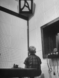 Young Boy Starring at the Loudspeaker Trying to Hear During a Medical Deafness Test Photographic Print by John Dominis