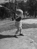 Two Year Old Golfer Bobby Mallick Taking a Swing Photographic Print by Al Fenn