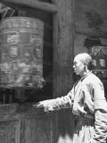 Student Monk Spins Wheel in Which Prayers Are Inscribed, at the Kumbun Lamaist Monastery Premium Photographic Print by Mark Kauffman