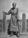 Monk Standing Outdoors at the Kumbun Lamaist Monastery Premium Photographic Print by Mark Kauffman