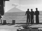 Sailors Watching Smoke Coming Out of the Top of Mt. Stromboli Premium Photographic Print by Tony Linck