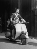 Mother and Baby Riding a Vespa Scooter Photographic Print by Dmitri Kessel