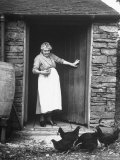 Mrs. Sarah Canon, Wearing a White Apron, Watching the Chickens Eat Their Feed Premium Photographic Print by George Rodger