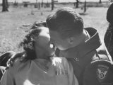 US Soldier and Local Girl Sharing a Kiss, Which is Not Allowed Premium Photographic Print by John Florea