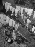 Mother Hanging Laundry Outdoors During Washday Fotoprint van Alfred Eisenstaedt