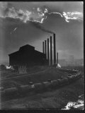 Massive Otis Steel Mill Surrounded by Tanker Cars on Railroad Track on a Cloudy Day Premium Photographic Print by Margaret Bourke-White