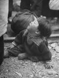 Refugee Child Sitting on Ground Premium Photographic Print by John Florea
