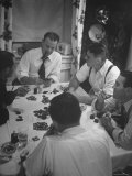 Men Playing Poker at Dining Room Table Covered with Chips, Cards, Ashtrays and Glasses Premium Photographic Print by Nina Leen