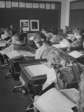 "Typical 10 Year Old Girls Known as "" Pigtailers"" Sitting in Classroom Premium Photographic Print by Frank Scherschel"