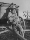 Oldest Working Buckaroo, Isador Lolo Munos, Wearing Traditional Cowboy Clothes, Sitting on Wagon Premium Photographic Print by John Florea