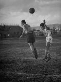 Player Bouncing the Ball from His Head Premium Photographic Print by John Florea