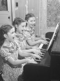 Set of Triplets Playing the Piano, Bernadine and Barbara Fronczak Premium Photographic Print by Francis Miller