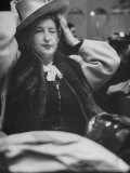 Woman Trying on a Hat at Ohrbach's Hat Dept Premium Photographic Print by Al Fenn